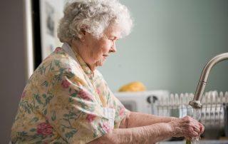 Senior woman doing household chores