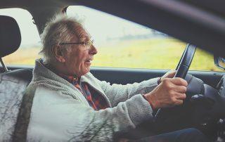 Old man drives car